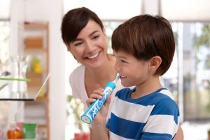 Kan børn tage skade af at bruge en elektrisk tandbørste?